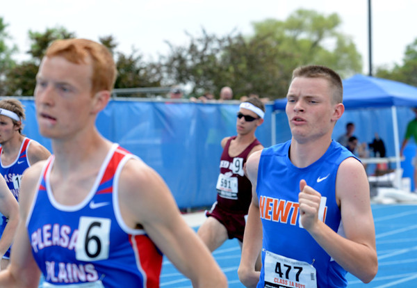 Newton's Joseph Stone runs with the pack in the 800-meter run at the Class 1A state preliminary meet at Eastern Illinois University.