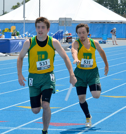 South Central student and Patoka track team member Chase Riley (left) takes the baton from Patoka track teammate Kasey Nance during the 4x200-meter relay at the Class 1A preliminary meet.