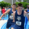 Teutopolis' Nick Bierman (left) hands off the baton to teammate Ben Sudkamp in the 4x200-meter relay at the Class 1A state preliminary meet at Eastern Illinois University.