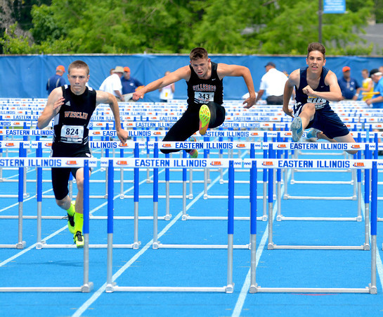 Teutopolis' Noah Blievernicht (right) races with the pack at the 110-meter high hurdles at the Class 1A state preliminary meet at Eastern Illinois University.