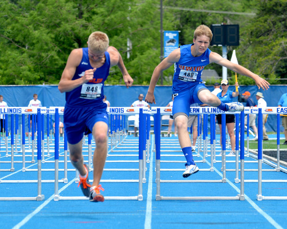 Newton's Jake Volk clears a hurdle and sprints toward the finish in the 110-meter hurdles at the Class 1A state preliminary meet at Eastern Illinois University.