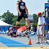 Teutopolis' Justin Hunt prepares to stick his landing during the long jump at the Class 1A preliminary meet at Eastern Illinois University, as Hunt advanced to Saturday's state finals.