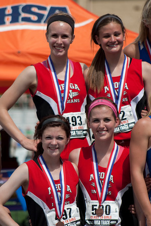 The Neoga 4x200-meter relay team of Courtney Croy, Jaycie Roy, Mallori Harshman and Olivia Ott pose with their medals.