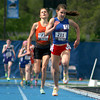 St. Anthony's Anna Sophia Keller leads the 1,600-meter run and Bryon's Kelsey Hildreth (orange) at the Class 1A state finals Saturday at Eastern Illinois University.