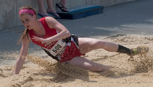 Olivia Ott, a junior at Neoga High School, lands after competing in the 1A Final Long Jump event at Eastern Illinois University for the Illinois High School Association state track and field competition.