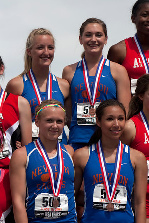 The Newton 4x200-meter relay team of Taylor Johnson, Hannah Litzleman, McKendra Barthleme and Madison Kinder poses with their medals at the Class 1A state finals.