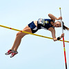 Teutopolis' Hannah Bueker clears the bar and looks back down during the pole vault.