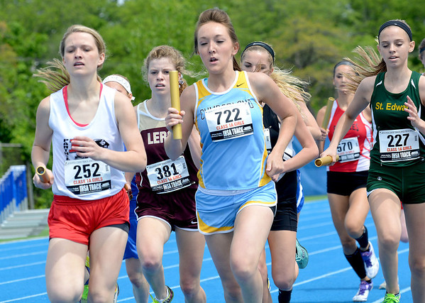 Cumberland's Leah Hutchison battles for first place during the 4x800-meter relay.