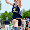 Teutopolis' Michelle Schmidt flies through the air after her final of three parts of the triple jump.