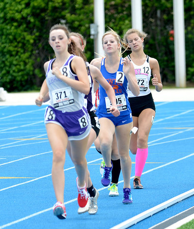 Newton's Lexie Davidson (center) runs with a group of runners during the 800-meter run.
