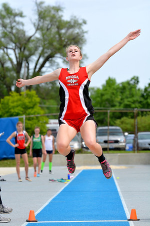 Neoga's Courtney Croy skies through the air during the long jump.