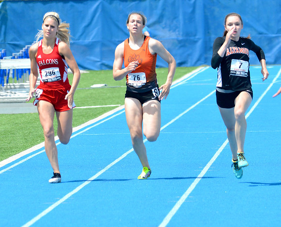 Altamont's Leah Goldstein (right) looks to break away from a pack of runners to her right during the 200-meter dash.