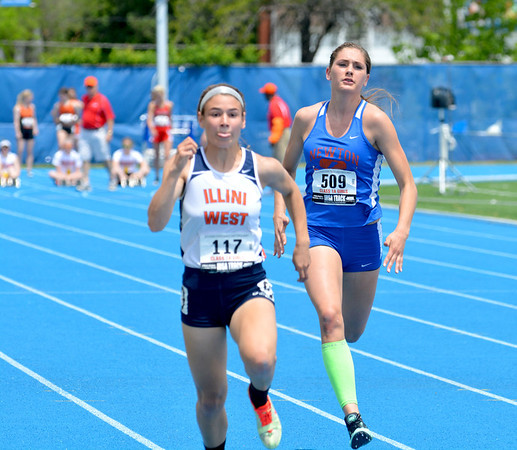 Newton's Hannah Litzelman trails behind Illini West's Paige Bray, who would win the heat in the 100-meter dash.