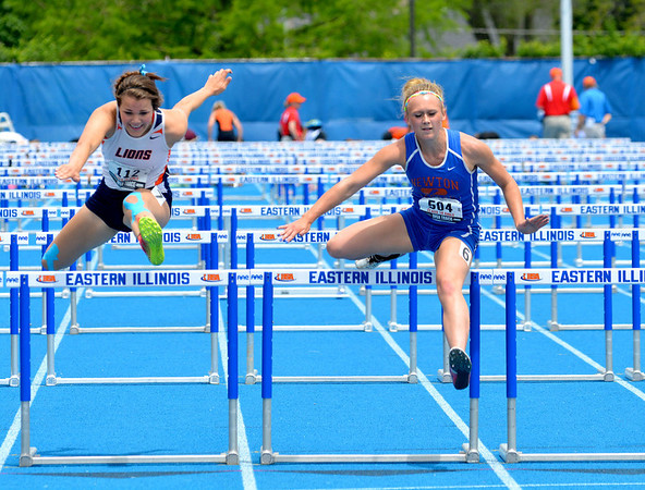 Newton's McKendra Barthelme clears a hurdle during the 110-meter high hurdles race.