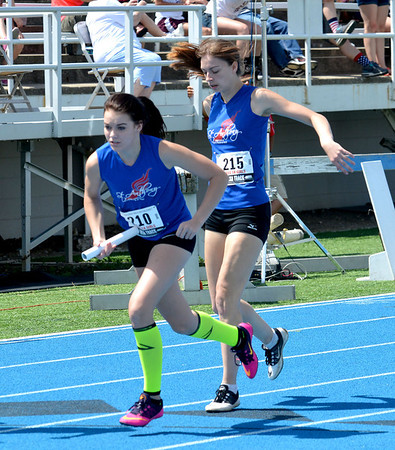 St. Anthony's Elizabeth Falconburg (left) takes off after receiving the baton from teammate Lauren Wendt in the 4x400-meter relay.