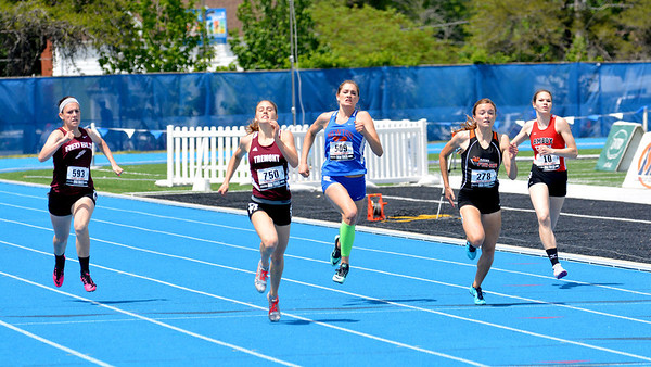 Newton's Hannah Litzelman (center) sprints in a pack of runners in the 200-meter dash.