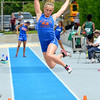 Newton's McKendra Barthelme soars through the air during a long jump attempt.
