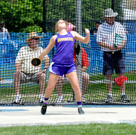 Brownstown's Molly Hill winds up and goes through her release during the discus competition.