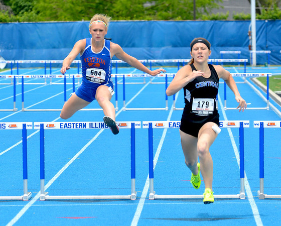 Newton's McKendra Barthleme jumps over a hurdle during the 300-meter intermediate hurdles race.