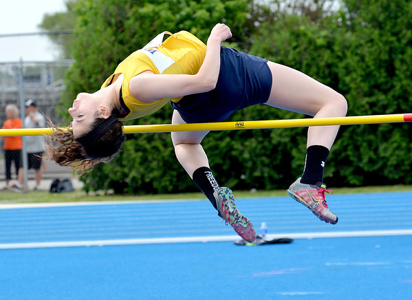 Windsor's Katie Hostetter attempts to clear the bar during the high jump.