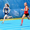 Teutopolis' Megan Weichman runs on the outside during the 400-meter dash.