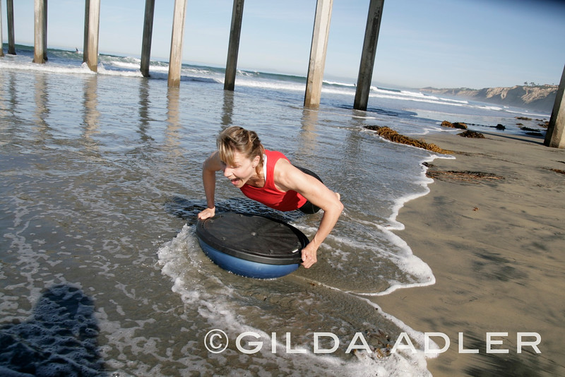I kept this one just because it makes me smile instantly! Claudia was SURPRISED  by the wave!!!
