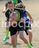 Clayton Copperhead Grant Kettner tries to escape from the grasp of a Fayetteville Griffin in this U-12 match.