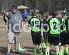 U-12 Coach J. G. Van Graan positions his players on the field.