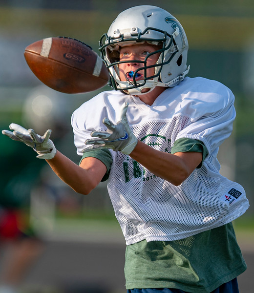 Clearfield High School's football team practice early Tuesday morning In Clearfield, On August 10, 2021.