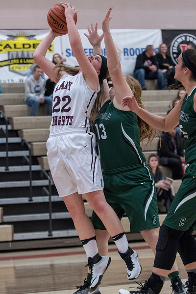 Lady Knight's Brynnley Christiansen (22) shoots the layup as Callin Mcgarry defends the shot at Northridge High School on Friday January 20, 2017.