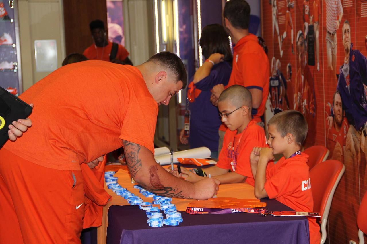 Passing out NEGU bracelets & getting autographs