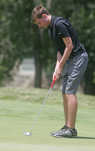 1JUL10 Medina's Mike Bishop sinks a putt at Red Tail Golf Club during the Cleveland Junior Open.  photo by Chuck Humel