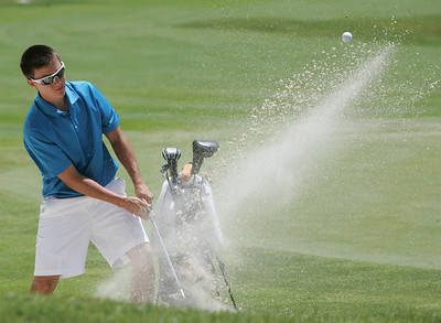 1JUL10 Avon's Beau Titsworth blasts out of a bunker at Red Tail Golf Club during the Cleveland Junior Open.  photo by Chuck Humel