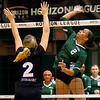 Alexis Middlebrooks hits over Green Bay's Taylor Totka in the Horizon League Championship on Nov. 19. STEVE MANHEIM / CHRONICLE