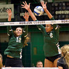 Cleveland State's Gina Kilner (12) and Alexis Middlebrooks defend against Green Bay in the Horizon League Championship on Nov. 19.  STEVE MANHEIM / CHRONICLE