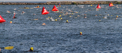 Cleveland Triathlon Swimming section in cleveland Harbour. Swimmers to the right are going out those to the left are returning. the returning swimmers in this photo are in the Olympic  event. Photo by Tom Mahl