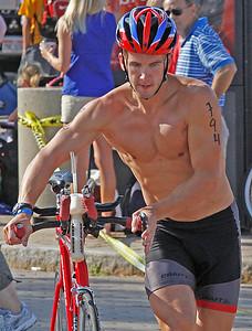 Cleveland Triathlon  Adam Kuncel finishes the bike ride. Photo by Tom Mahl