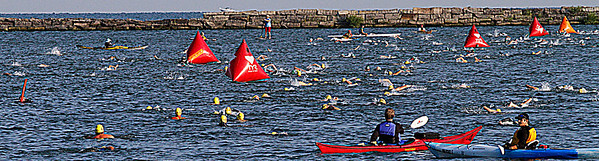 Cleveland Triathlon Swimming section in cleveland Harbour.Swimmers on the  right are going out. those on the left are returning. Photo by Tom Mahl