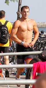 Cleveland Triathlon  Adam Kuncel  just after finishing  bike ride he starts the run. Photo by Tom Mahl
