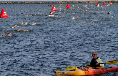 Cleveland Triathlon Swimming section in cleveland Harbour. Photo by Tom Mahl