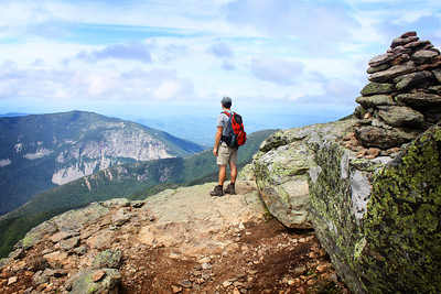Standing on the Franconia Ridge Trail overlooking Cannon Cliff in Franconia Notch State Park, New Hampshire.