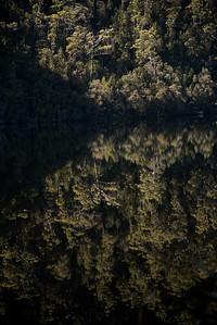 A lake and its reflection.