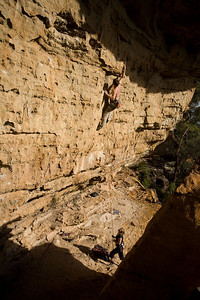 Setting up for the crux move on Long Dong Silver (24/25) on the Pocketed Porn wall.