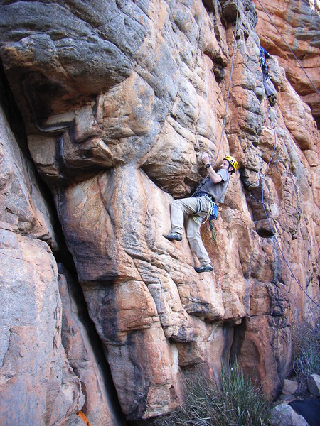 Peter trying a new route, Arapiles.