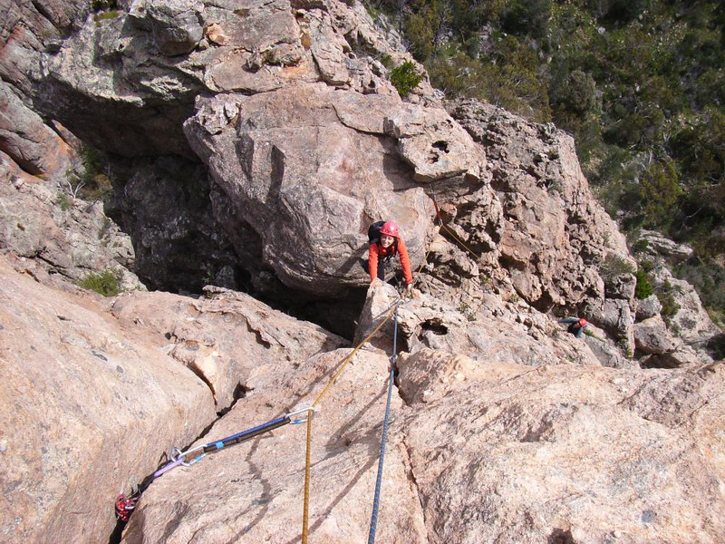 Irina stepping across the gap on the last pitch of Spiral Staircase 8.