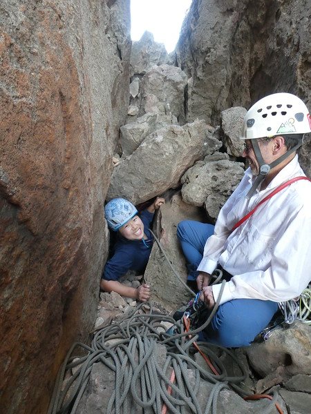 Yushu in the Belltower chimney squeeze, Mitre Rock, Arapiles.