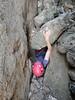 Sarah in the Belltower chimney squeeze, Mitre Rock, Arapiles.