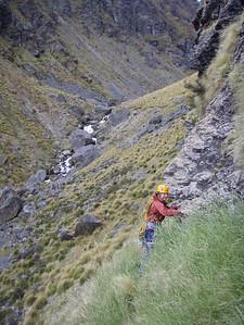 Descent across the grass ledge system