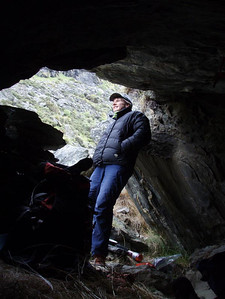 Checking the weather from the bivi cave at Wye Creek upper.
