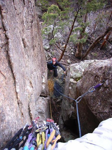 Cameron belaying at the base of Squeeze Box 13.